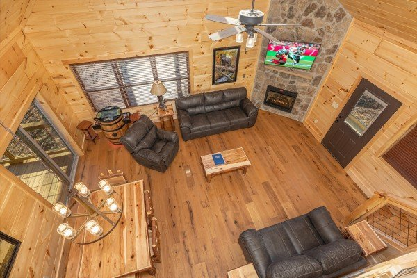 Looking down at the living room and dining room at Bessy Bears Cabin, a 2 bedroom cabin rental located inGatlinburg