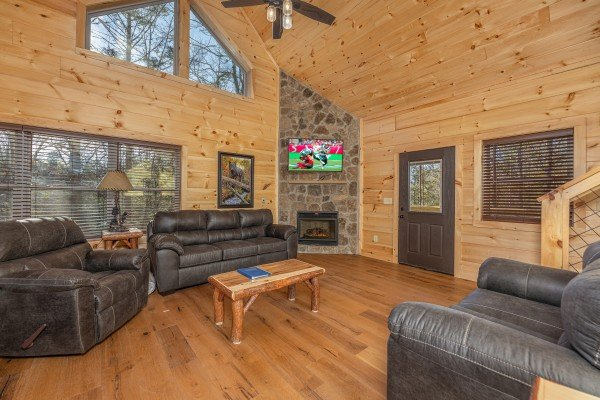Vaulted living room with fireplace and TV at Bessy Bears Cabin, a 2 bedroom cabin rental located inGatlinburg
