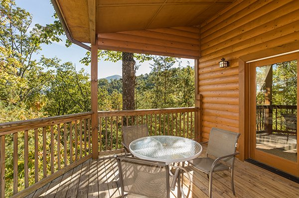 Deck dining table for three at Mountain Valley Hideaway, a 2 bedroom cabin rental located in Pigeon Forge