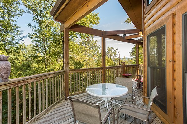 Deck dining for four at Mountain Valley Hideaway, a 2 bedroom cabin rental located in Pigeon Forge
