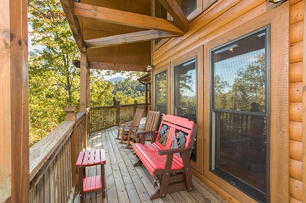 Custom glider on the deck at Mountain Valley Hideaway, a 2 bedroom cabin rental located in Pigeon Forge