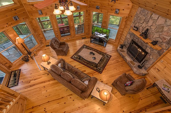 Looking down to the living room from above at Mountain Valley Hideaway, a 2 bedroom cabin rental located in Pigeon Forge