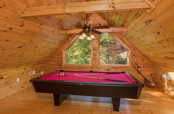 Pool table in the game loft at Mountain Valley Hideaway, a 2 bedroom cabin rental located in Pigeon Forge