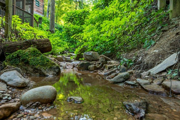 Creek near the hot tub at Cabin by the Creekside, a 4 bedroom cabin rental located in Pigeon Forge