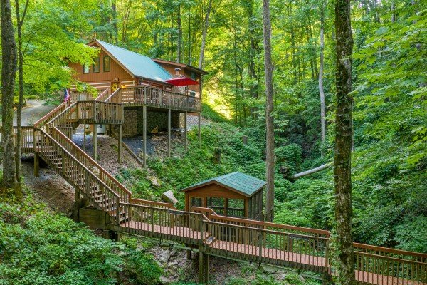 Cabin, hot tub gazebo, and catwalk over the creek at Cabin by the Creekside, a 4 bedroom cabin rental located in Pigeon Forge