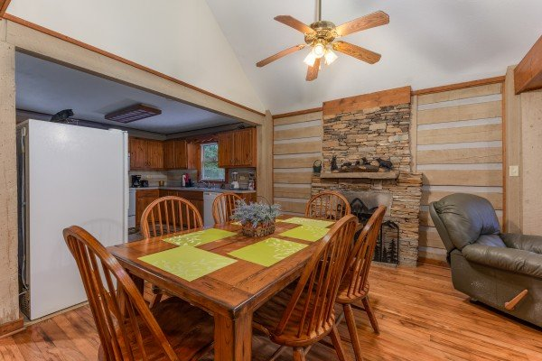 Dining room for six with a fireplace at Cabin by the Creekside, a 4 bedroom cabin rental located in Pigeon Forge