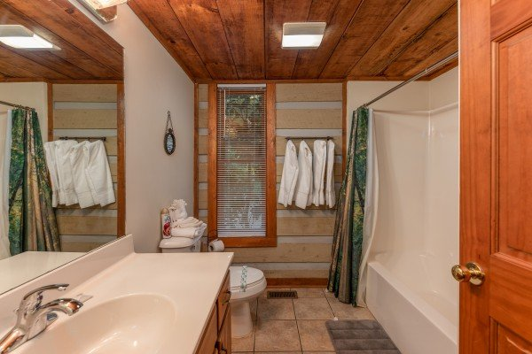 Bathroom with a tub and shower at Cabin by the Creekside, a 4 bedroom cabin rental located in Pigeon Forge