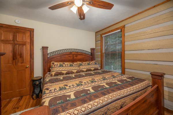 Bedroom with a king bed at Cabin by the Creekside, a 4 bedroom cabin rental located in Pigeon Forge