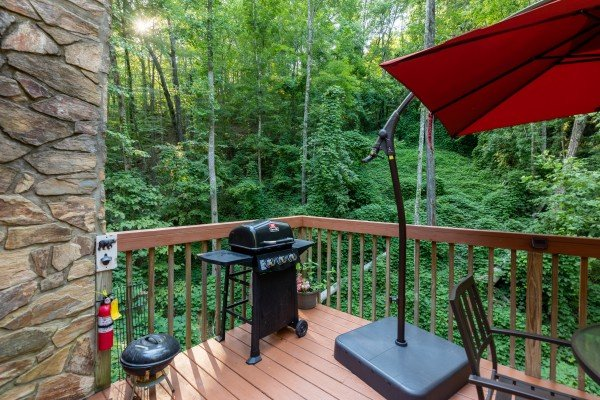 Grill on the deck at Cabin by the Creekside, a 4 bedroom cabin rental located in Pigeon Forge