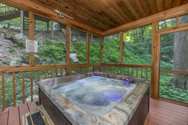 Hot tub in a gazebo on the deck at Cabin by the Creekside, a 4 bedroom cabin rental located in Pigeon Forge