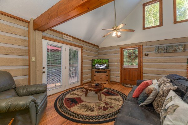 TV and deck access in a living room at Cabin by the Creekside, a 4 bedroom cabin rental located in Pigeon Forge