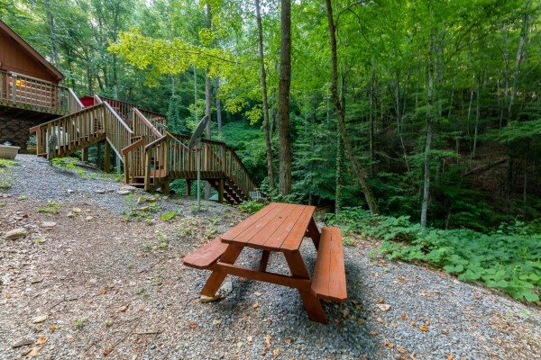 Picnic table in the parking area at Cabin by the Creekside, a 4 bedroom cabin rental located in Pigeon Forge