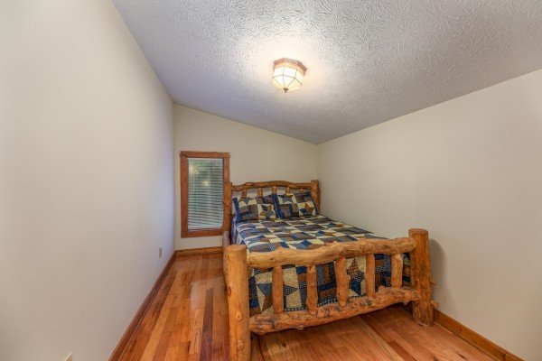 Bedroom with a full bed at Cabin by the Creekside, a 4 bedroom cabin rental located in Pigeon Forge
