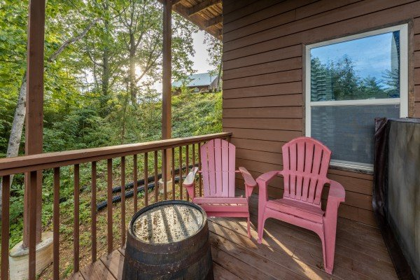 Red Adirondack chairs on the lower deck at Bearing Views, a 3 bedroom cabin rental located in Pigeon Forge