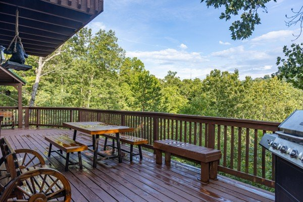 Deck dining area with a gas grill at Bearing Views, a 3 bedroom cabin rental located in Pigeon Forge