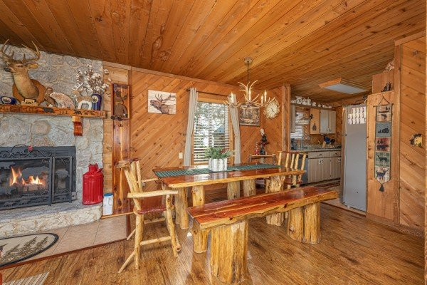 Dining space with seating for six next to the fireplace at Bearing Views, a 3 bedroom cabin rental located in Pigeon Forge