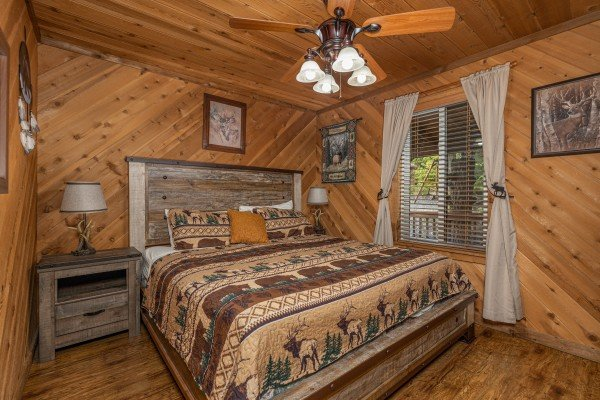 Bedroom with a king bed, two night stands, and two lamps at Bearing Views, a 3 bedroom cabin rental located in Pigeon Forge