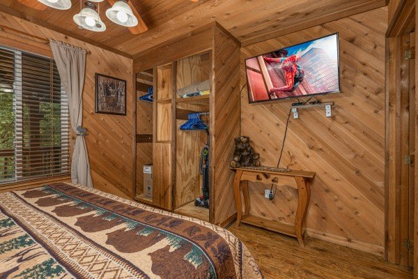 Closet and TV in a bedroom at Bearing Views, a 3 bedroom cabin rental located in Pigeon Forge