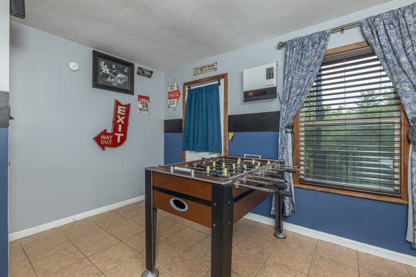 Foosball table in the game room at Bearing Views, a 3 bedroom cabin rental located in Pigeon Forge