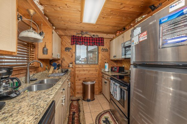 Galley kitchen with stainless appliances at Bearing Views, a 3 bedroom cabin rental located in Pigeon Forge