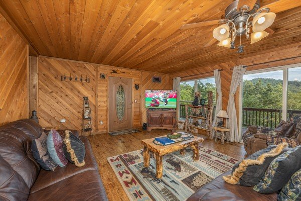TV in a living room with mountain views at Bearing Views, a 3 bedroom cabin rental located in Pigeon Forge