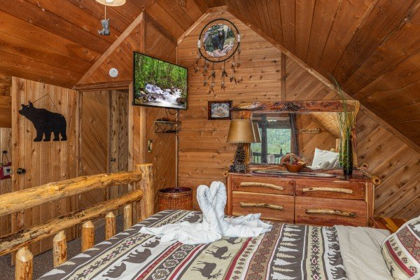 TV, dresser, and mirror in a bedroom at Bearing Views, a 3 bedroom cabin rental located in Pigeon Forge