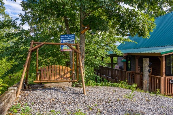Swing in the yard at Bearing Views, a 3 bedroom cabin rental located in Pigeon Forge