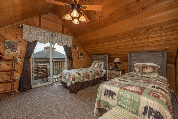 Bedroom with two twin beds and deck access at Bearing Views, a 3 bedroom cabin rental located in Pigeon Forge