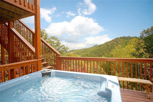 first floor deck with jacuzzi at mountain spirit a 4 bedroom cabin rental located in pigeon forge