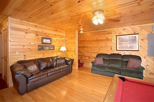 first floor game room with sofa bed at mountain spirit a 4 bedroom cabin rental located in pigeon forge