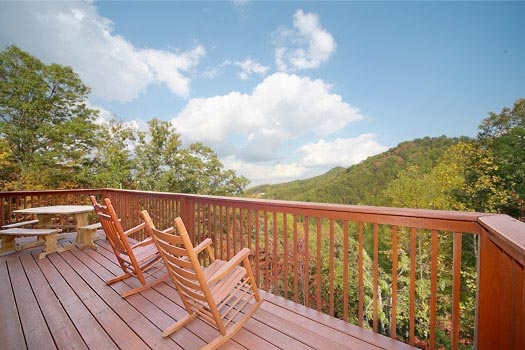 main level deck with rocking chairs at mountain spirit a 4 bedroom cabin rental located in pigeon forge