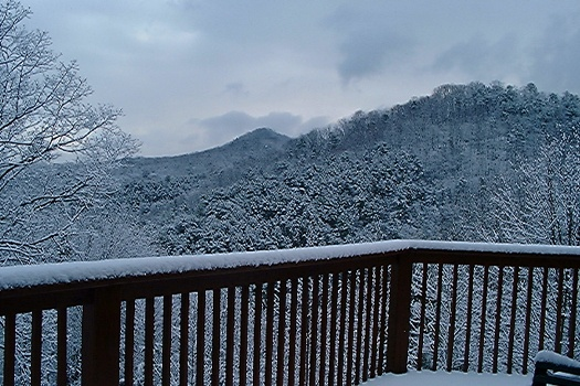 view of snow capped smoky mountains at mountain spirit a 4 bedroom cabin rental located in pigeon forge