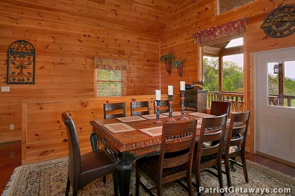Dining room with seating for 8 at Privacy & A View, a 3 bedroom cabin rental located in Pigeon Forge