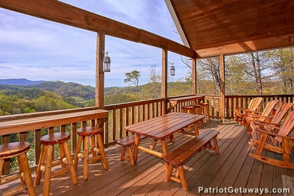 Deck with lots of seating options at Privacy & a View, a 3 bedroom cabin rental located in Pigeon Forge