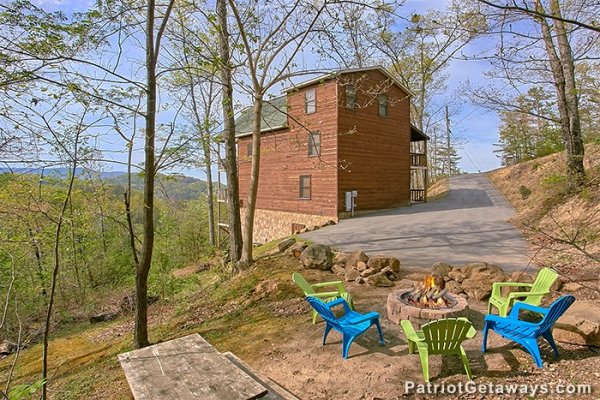 Fire pit with plenty of Adirondack chairs at Privacy & a View, a 3 bedroom cabin rental located in Pigeon Forge