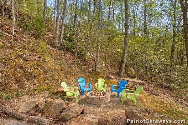 Fire pit with Adirondack chairs at Privacy & A View, a 3 bedroom cabin rental located in Pigeon Forge