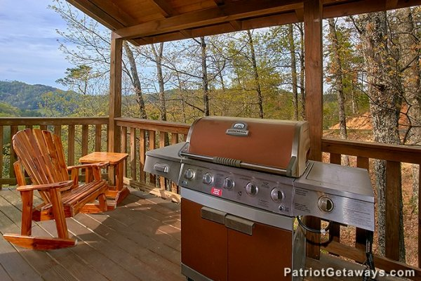 Propane grill on the covered deck at Privacy & A View, a 3 bedroom cabin rental located in Pigeon Forge