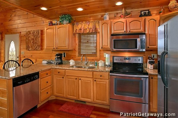 Kitchen with granite counters and stainless appliances at Privacy & A View, a 3 bedroom cabin rental located in Pigeon Forge