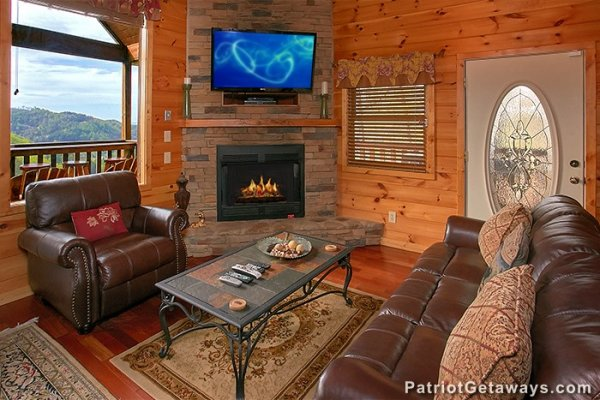 Living room with fireplace, TV, and mountain views at Privacy & a View, a 3 bedroom cabin rental located in Pigeon Forge
