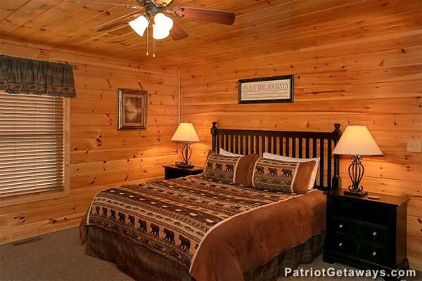 King sized bed and two nights stands at Privacy & A View, a 3 bedroom cabin rental located in Pigeon Forge