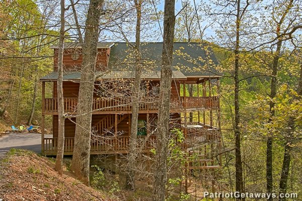 Looking back at Privacy & A View, a 3 bedroom cabin rental located in Pigeon Forge through the trees