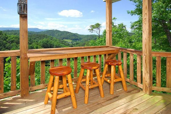Outdoor bar seating with a mountain view at Privacy & A View, a 3 bedroom cabin rental located in Pigeon Forge