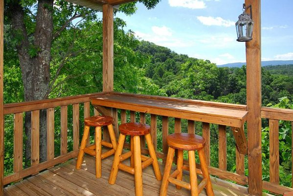 Second outdoor bar seating area with mountain views at Privacy & A View, a 3 bedroom cabin rental located in Pigeon Forge