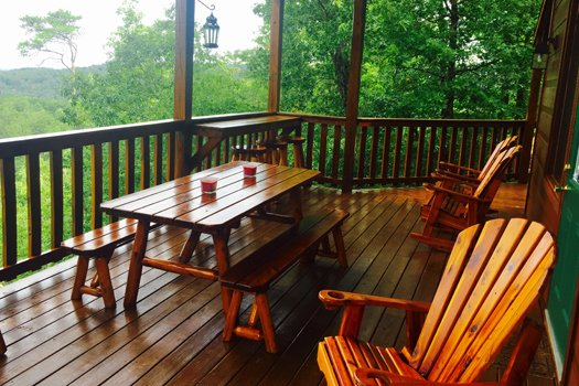 Deck after a rain at Privacy & A View, a 3 bedroom cabin rental located in Pigeon Forge