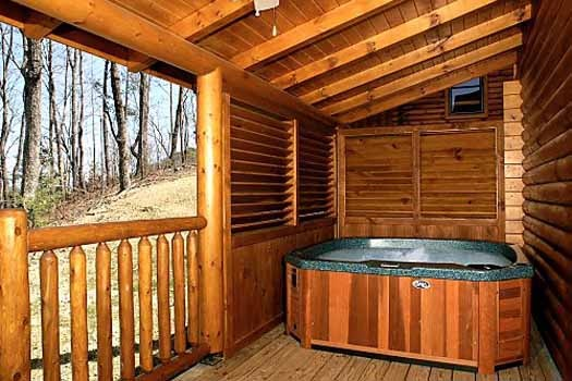 covered deck with hot tub at starry starry night a 2 bedroom cabin rental located in pigeon forge