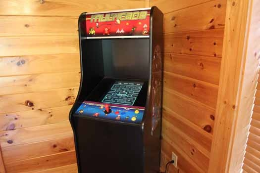 game room with arcade game at starry starry night a 2 bedroom cabin rental located in pigeon forge