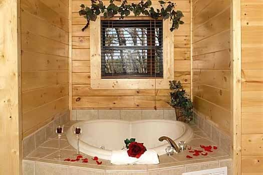 in bedroom heart shaped jacuzzi tub at starry starry night a 2 bedroom cabin rental located in pigeon forge