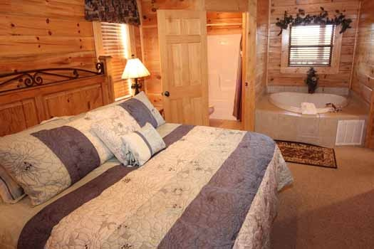 king bedroom with jacuzzi tub at starry starry night a 2 bedroom cabin rental located in pigeon forge