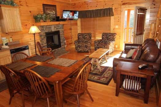 living room with dining room table at starry starry night a 2 bedroom cabin rental located in pigeon forge
