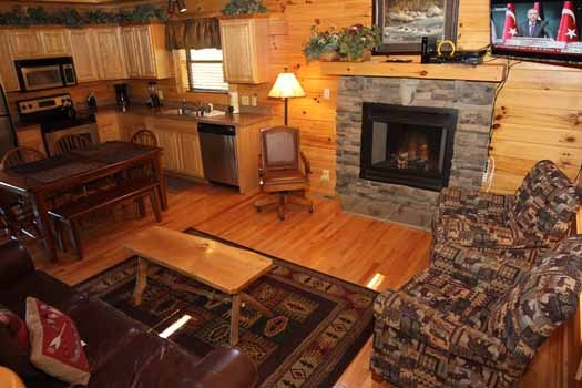 living room with fireplace at starry starry night a 2 bedroom cabin rental located in pigeon forge